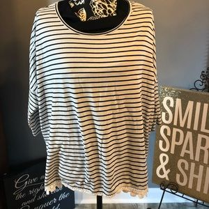 Black and white stripe shirt with lace trim.